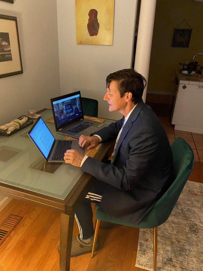 Mr. White, shown here in his teaching space at home, has found virtual teaching to be a difficult endeavor that takes a significant amount of planning.
