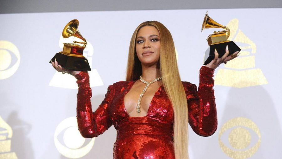 Beyonce poses backstage in 2017 with her two Grammy awards.
